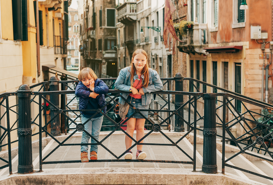 Two kids playing on the bridge