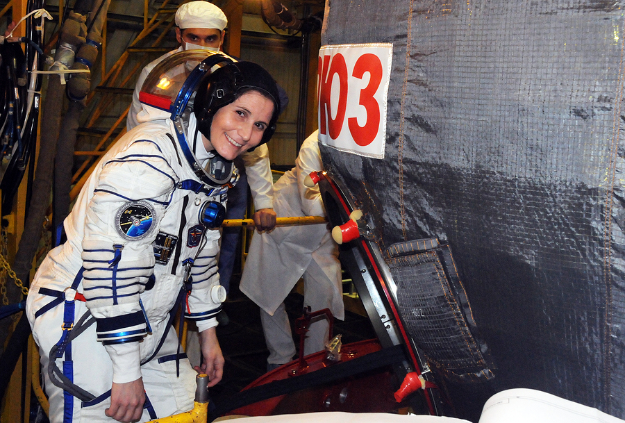 Flight engineer Samantha Cristoforetti before entering Soyuz TMA-15M spacecraft hatch for a dress rehearsal fit check