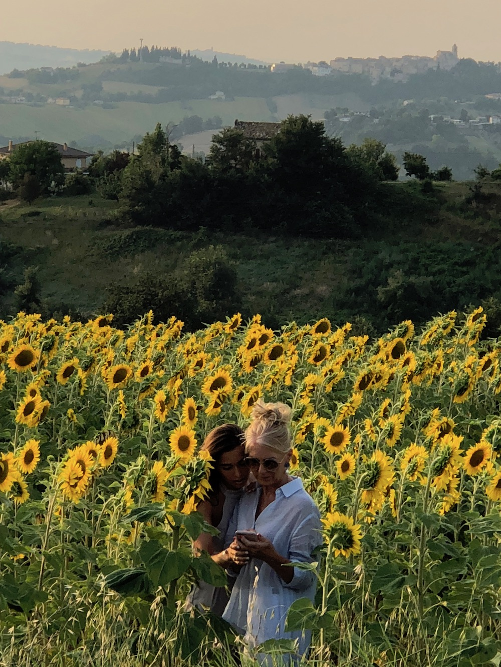 Dawn and her daughter Camilla, checking out the local fields of sunflowers