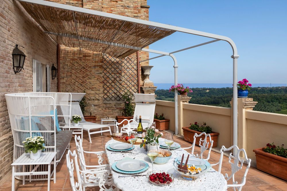 Dining alfresco on one of the terraces at Villa Veneto