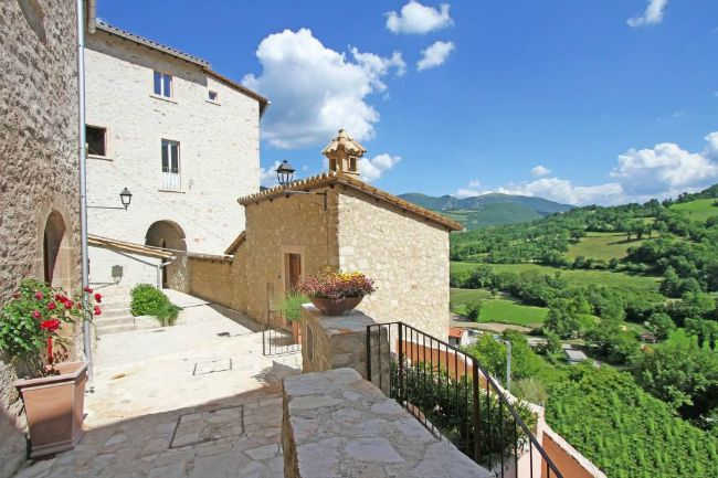 Living slow in a restored village in umbria italy magazine for 1 homes in italy
