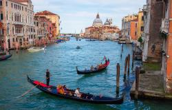 Gondolas on a canal in Venice Italy