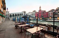 empty tables by the Rialto bridge in Venice
