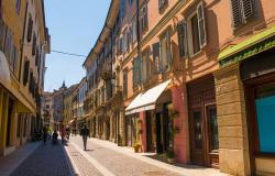 People walk down the historic Via Rastello in the north eastern Italian city of Gorizia in the Friuli Venezia Giulia region