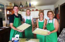 Happy group over their freshly made potato gnocchi