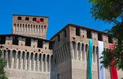 Italian flag draped over Castle of Montechiarugolo Emilia-Romagna