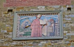 Plaque depicting Dante on a wall in the streets of Florence