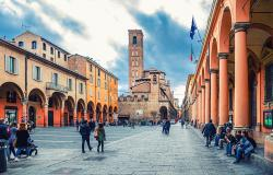 People walking on a street in Bologna and portico