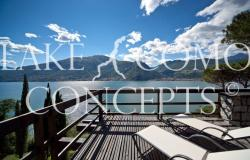 Luxury lakefront villa with private beach, pool & boat mooring! 0