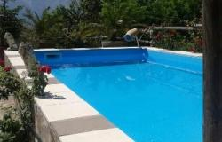Detached 4 bed Farm house with 5000sqm of land, swimming pool and 200 meters from the town center. 0