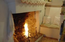 original feature, open fire in traditional kitchen