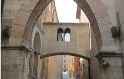 Stone arches next to the church of San Gemigniano in Modena