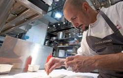 Chef Enrico Crippa working in the kitchen at Piazza Duomo in Alba Italy