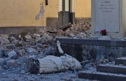 Toppled statue and rubble in Sicilian village after earthquake struck