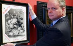 Uffizi director Eike Schmidt holds copy of painting stolen during World War II