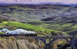 The Val D'Orcia steam train crossing the Tuscan hilly landscape