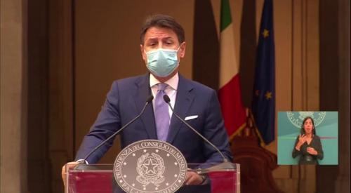 Italy's premier Giuseppe Conte wearing face mask during press conference