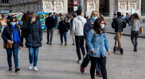 People wearing face masks in Milan