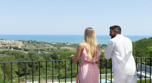 couple looking over the balcony