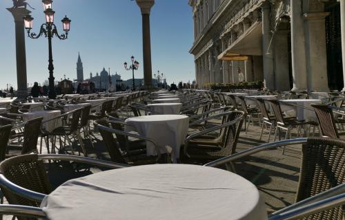 Empty tables in St. Mark's Square in Venice Italy