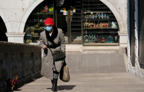 Woman walking with face mask in Italy