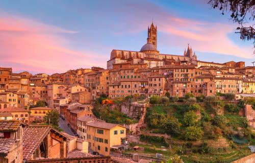 View of Siena in Italy at sunset