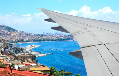Plane flying over Naples Italy