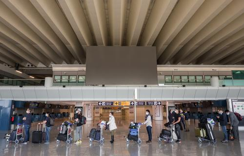 Passengers waiting in line at Rome's Fiumicino airport