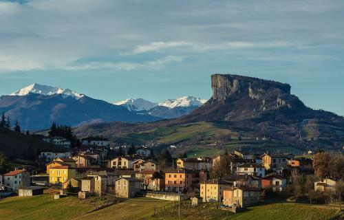Castelnovo ne' Monti village and the Pietra di Bismantova rock in the background