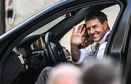 Tom Cruise waving from car while filming Mission Impossible 7 in Rome