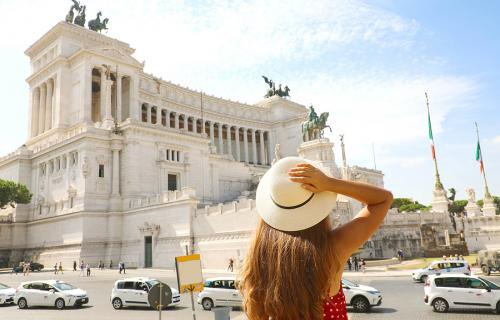 A girl looks at Piazza Venezia in Rome