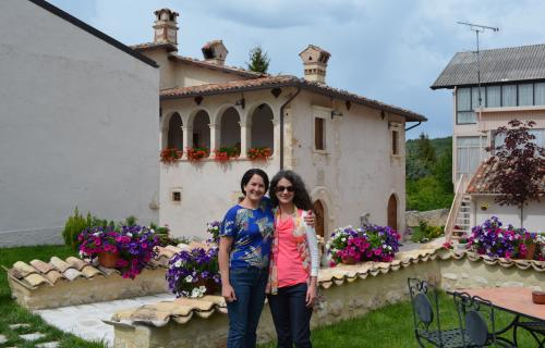 Janet Badia and her sister Lisa in the courtyard of their Barisciano B&B