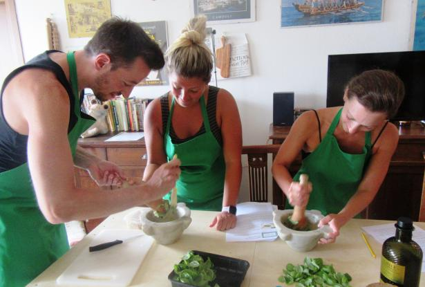Pounding basil leaves for making pesto