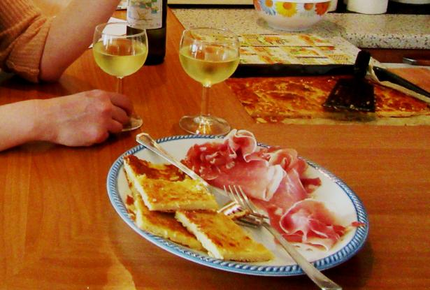 White wine and farinata as aperitif