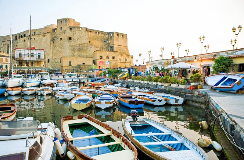 Castel dell'Ovo and harbor with boats in Naples