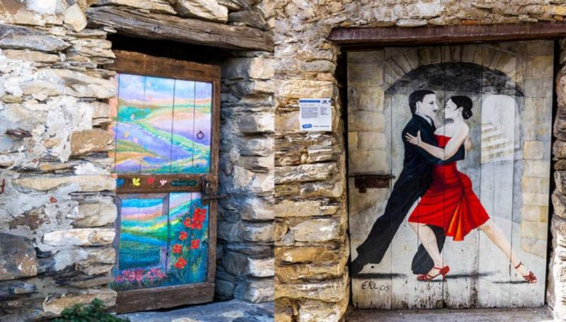 Painted doors in the village of Valloria Liguria