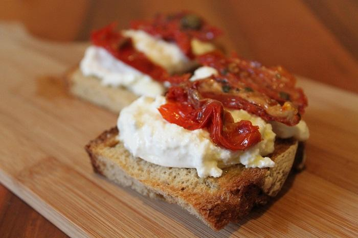 Crostini with Burrata Cheese and Sun-Dried Tomatoes. Ph. credit Coral Sisk