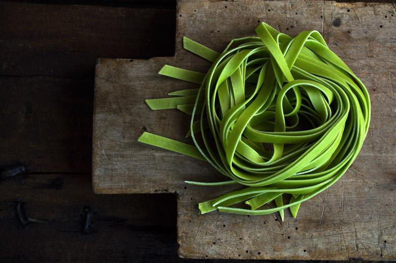 Tagliatelle pasta that has been dyed green.