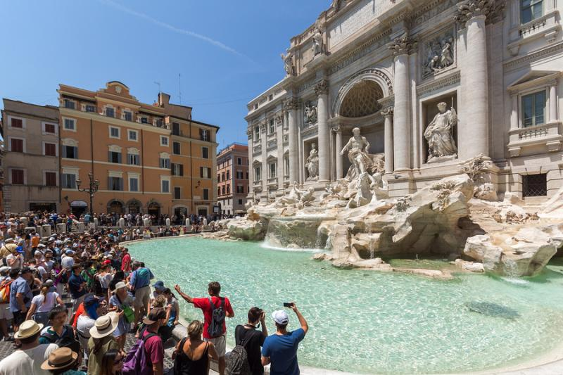 Tourist crowds in front of the Trevi Fountain in Rome